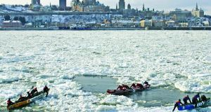 An ice canoe race on the Saint Lawrence River is part of the Carnaval de Québec.