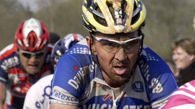 Belgium's Johan Museeuw rides in the 2004 Paris-Roubaix cycling race. Photograph: Damien Meyer/AFP/Getty Images