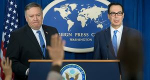 US secretary of state Mike Pompeo  and US treasury secretary Steven Mnuchin announcing sanctions against Iran in Washington on Monday. Photograph:  Michael Reynolds/EPA
