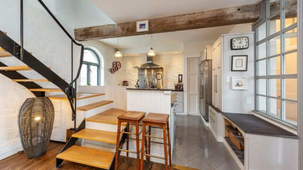 Open tread timber staircase leads to two double-bedrooms, both en-suite
