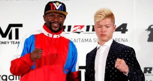 Floyd Mayweather poses with Japanese kickboxer Tenshin Nasukawa after they agreed to fight in Japan on  New Year's Eve, with the format of the bout still to be decided. Photograph: Issei Kato/Reuters