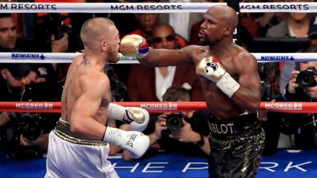 Floyd Mayweather throws a punch at Conor McGregor during their super welterweight boxing match at the T-Mobile Arena in Las Vegas in August 2017. Photograph: Sean M Haffey/Getty Images