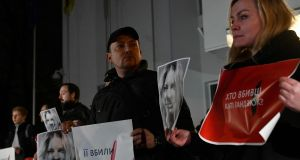 Protesters demonstrate in front of Ukraine's ministry of internal affairs in remembrance of  anti-corruption campaigner Kateryna Handziuk. Photograph: Genya Savilov/AFP/Getty Images