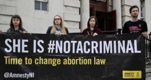 Campaigners demonstrate in support of the woman during a hearing in the case in September. Photograph: Brian Lawless/PA Wire