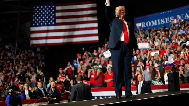 US president Donald Trump at a campaign rally on the eve of the US midterm elections in Cape Girardeau, Missouri. Photograph: Carlos Barria/Reuters