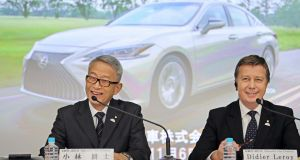 Toyota Motor Corporation executive vice presidents Koji Kobayashi  and Didier Leroy during a press conference announcing Toyota's financial results for the six month period ended September 30th.