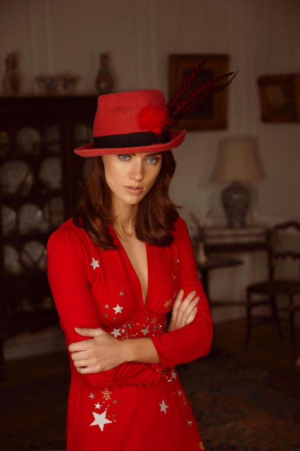 Red silk dress with embroidered stars and moons (€380, Rixo, Brown Thomas), faux snakeskin boots River Island, pink trilby with twisted crown and pheasant feather (€250 Anthony Peto)