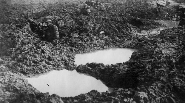 Soldiers of the 16th Canadian machine gun regiment using shell holes as makeshift defences at Passchendaele Ridge. Photograph: William Rider-Rider/Getty Images
