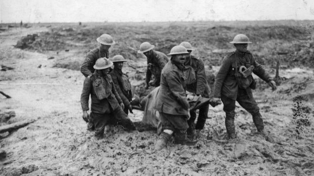 A stretcher-bearing party carrying a wounded soldier through the mud near Boesinghe during the battle of Passchendaele in Flanders. Photograph: John Warwick Brooke/Getty Images