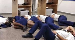 The photograph showing Ryanair staff on the floor of a crew room in Malaga airport