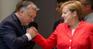 Hungarian prime minister Viktor Orban and German chancellor Angela Merkel at the European Council summit in Brussels in June. Photograph: Stephanie Lecocq/EPA