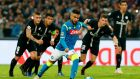 Napoli's Lorenzo Insigne scores from the penalty spot against PSG. Photograph: Ciro De Luca/Reuters