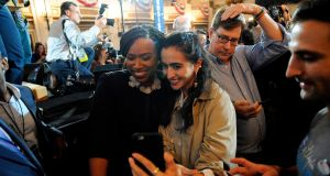 Congresswomen Ayanna Pressley (left) poses for selfies with supporters at the Fairmont Copley Hotel in Boston. Photograph: Getty Images