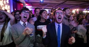 Supporters cheer at a Democratic Congressional Campaign Committee midterm election watch party in Washington. Photograph: New York Times