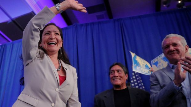 Deb Haaland takes the stage in Albuquerque. Photograph: Reuters