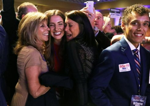 Supporters of Republican gubernatorial candidate Ron DeSantis celebrate at his midterm election night party in Orlando, Florida. Photograph: REUTERS/Carlo Allegri