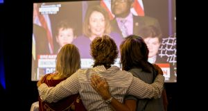 Supporters of congressional candidate Harley Rouda watch Nancy Pelosi speak on a big screen in Newport Beach, California. Photograph: New York Times