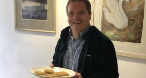 Ronan McGreevy with the  wartime biscuits reproduced by DIT's bakery department for a history exhibition.