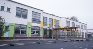 Protective fencing erected outside Gaelscoil Eiscir Riada, Glebe, Lucan, Co Dublin. It is one of dozens of schools at the centre of structural concerns.  Photograph: Tom Honan