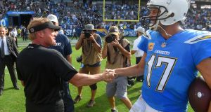 Gruden congratulates Los Angeles Chargers quarterback Philip Rivers the Chargers' win last month. Photo: Scott Varley/Digital First Media/Torrance Daily Breeze via Getty Images