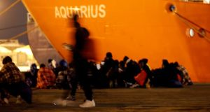File photo: Migrants disembark from the MV Aquarius, a search and rescue ship run in partnership between SOS Mediterranee and Medecins Sans Frontieres, after it arrived in Augusta on the island of Sicily, Italy on January 30th, 2018 Photograph: Reuters/Antonio Parrinello