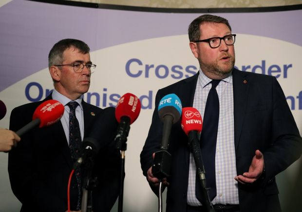 Garda Commissioner Drew Harris (left) and PSNI temporary deputy chief constable Stephen Martin address the media during the cross-Border conference on organised crime Newcastle, Co. Down on November 7th Photograph: Brian Lawless/PA Wire