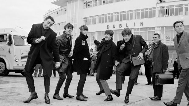 The Beatles arrive in Ireland to play their two concerts in the Adelphi cinema on November 7th, 1963. Alongside them is radio and TV personality Paul Russell (left), with Frank Hall on the right. Photograph: Lensmen/Irish Photo Archive