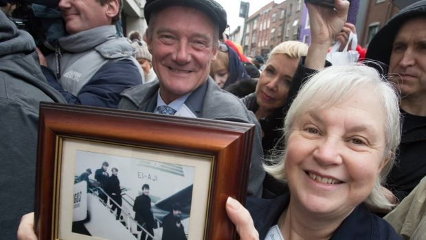 Members of Beatles Ireland, Pete Brennan and Pat Moore, hold up a picture of the Beatles arriving into Dublin for their concerts. Photograph: Colm Mahady /Fennells