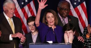Nancy Pelosi's grandson Paul covers his eyes as he and his brother Thomas join their grandmother in Washington as she celebrates the Democrats' success in winning a majority in the House of Representatives in the US midterm elections. Photograph: Jonathan Ernst/Reuters