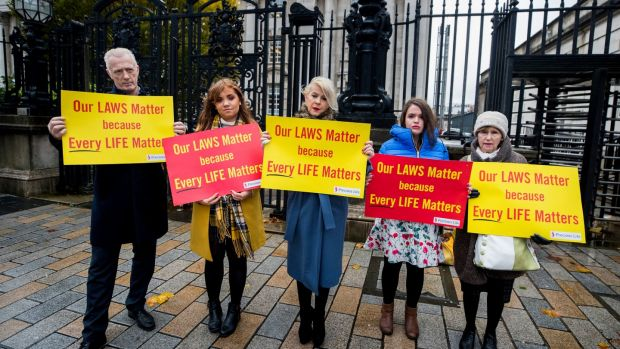 Bernie Smyth (centre), founder and director of Precious Life with anti-abortion campaigners outside Belfast High Court on Tuesday. Photograph: Liam McBurney/PA