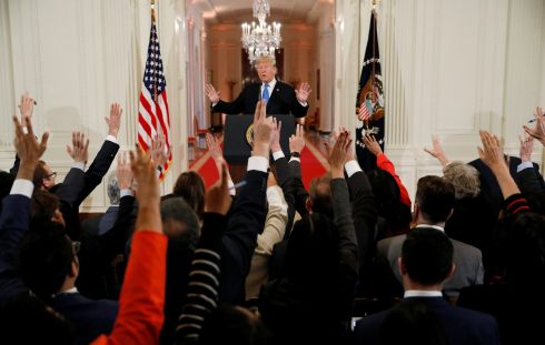 NEXT: Reporters raise their hands to ask US president Donald Trump questions at a news conference. Photograph: Kevin Lamarque/Reuters