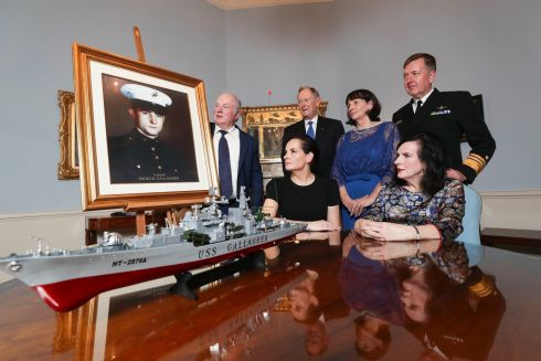 PROUD AS PUNCH: Naval Service Chief of Staff vice-admiral Mark Mellett and Gen Walter Eugene Boomer (retired) who served with Cpl Patrick Gallagher next to Gallagher's siblings Peter, Pauline, Theresa and Rosemary with a portrait of their brother and a replica of the USS Patrick Gallagher, which was named in his honour, at a reception hosted by Lord Mayor of Dublin Nial Ring marking the event. Photograph: Conor McCabe Photography