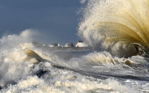SURF'S UP: Waves break in the port of Lesconil, western France. Photograph: Fred Tanneau/AFP/Getty Images