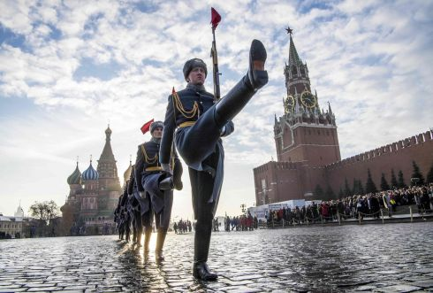 FORWARD, MARCH: Russian honour guards march during the military parade at Red Square in Moscow to mark the 77th anniversary of the march past the Kremlin walls towards the front line to fight Nazi Germany troops during the second World War. Photograph: Mladen Antonov/AFP/Getty Images