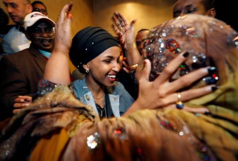 WE DID IT! Democratic congressional candidate Ilhan Omar is greeted by her husband's mother after appearing at her midterm election night party in Minneapolis, Minnesota. The Somali-American was re-elected to the House of Representatives on Tuesday. Photograph: Eric Miller/Reuters