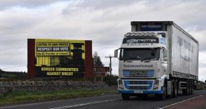 A lorry crosses the Border past a Border Communities Against Brexit billboard in Newry on October 9th, 2018 Photograph: Charles McQuillan/Getty