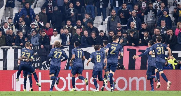 7c19bcc0 Manchester United's players celebrate after an own goal from Juventus' Alex  Sandro gave United victory