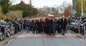 Rows of bikers line the street as the remains of David Boland, who died after he was stabbed on Halloween night, are carried from the Sacred Heart Church, Nurney, Co. Kildare to the local cemetery. Photograph: Colin Keegan, Collins.