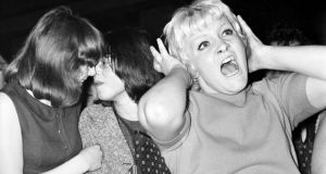 Lesbian kiss: Jack White posted this photograph of Beatles fans in 1964 to express his disappointment at Allyson MacIvor's treatment at his Edmonton concert. Photograph: Mirrorpix/Getty