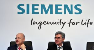 Joe Kaeser (right), chief executive of  Siemens, and chief financial officer Ralf Thomas attend their company's annual results press conference in Munich, Germany, on Thursday. Photograph: Christof Stache/AFP/Getty Images