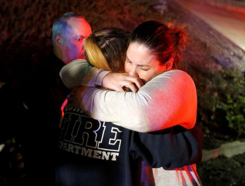 THOUSAND OAKS SHOOTING: People comfort each other after a mass shooting at a bar in Thousand Oaks, California, US. Photograph: Ringo Chiu/Reuters