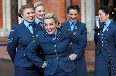 TRIBUTE ACT: Singing group The D-Day Darlings take part in the unveiling ceremony of a permanent war memorial at St Pancras station in London, Britain. Photograph: Peter Nicholls/Reuters