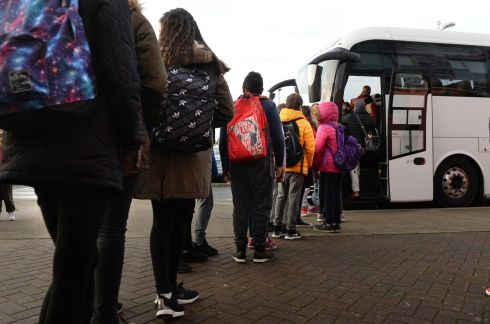 SCHOOL CLOSURES: Buses line up at the Educate Together school in Tyrrelstown, Co Dublin, to take children to alternative facilities. Photograph: Dara Mac Dónaill/The Irish Times