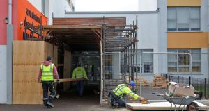 Builders carrying out remedial work at Tyrrelstown Educate Together School in Dublin  earlier this week. The school closed to pupils last week due to building defects. Photograph:  Colin Keegan/Collins