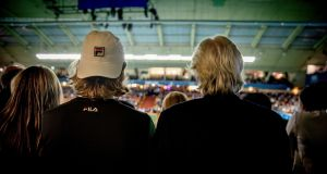 Leo Borg and his father, Björn Borg, watch a Stockholm Open match. Photograph: Casper Hedberg/The New York Times