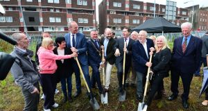 Simon Coveney (left with shovel) turning the sod in June 2016 on a planned redevelopment of the Dominick Street flats during his time as minister for housing. Photograph: Dara Mac Dónaill