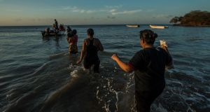 File photo: Migrants wade to a smuggler's boat that will take them from Venezuela to the Caribbean island of Curacao on September 26th, 2016. Photograph: Meridith Kohut/The New York Times