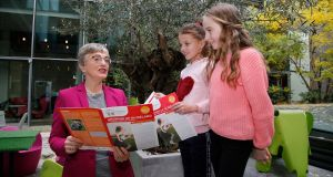 Minister for Children Dr Katherine Zappone with Jessica Shaw and Niamh Finglas from Louth after the Minister launched four new childcare reports on Thursday. Photograph: Nick Bradshaw
