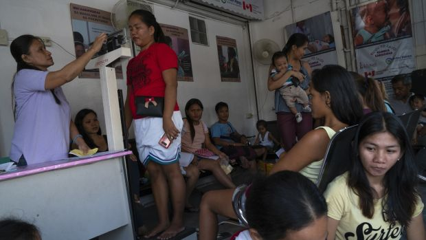 The waiting area of Likhaan clinic in Tondo, Manila. Likhaan is a nonprofit nongovernment organisation providing free consultation and family planning methods such as implants and IUD to women especially in marginalised communities. Photograph: Kimberly dela Cruz