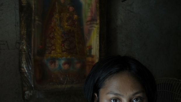 Zia (19) poses for a portrait inside her home in Manila. She had a backdoor abortion when she was 14. She went to a hospital after 2 weeks of profuse bleeding. Photograph: Kimberly dela Cruz